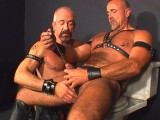 Decadent leather bear spreads his ass for dick