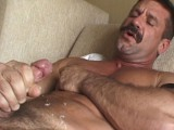 Beefy hirsute hands jerk off a powerful shaft