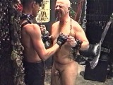 Fat thrall brought down to be abused by leather-clad dom