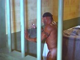Concupiscent bully inmate uses prison cell gloryhole