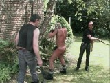 Outdoor male villein bound and whipped by a evil Masters