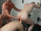 Two slaveboys sharing a big double ended sex gear