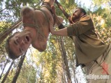 Bound Christian Wilde supplicates to cum in the woods